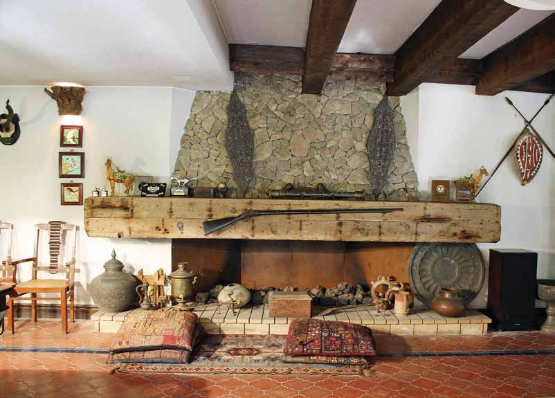 Basement wooden and stone fireplace