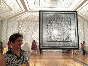 """Anila Q. Agha with her prize winning artwork """"Intersections"""""""